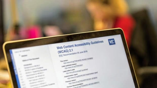 A laptop open to a webpage title 'Web Content Accessibility Services (WCAG) 2.1
